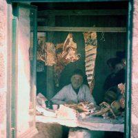 "Photo by John Cimin Walburg: 1915 ""The butcher's shop."""